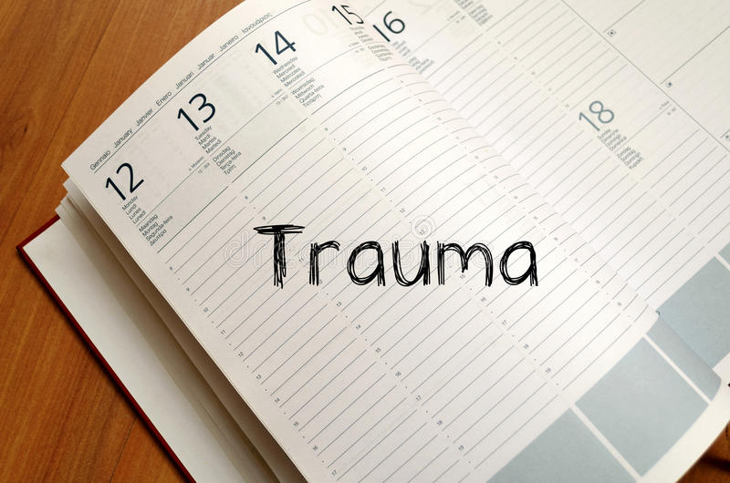 Trauma write on notebook. Trauma text concept write on notebook with pen stock image
