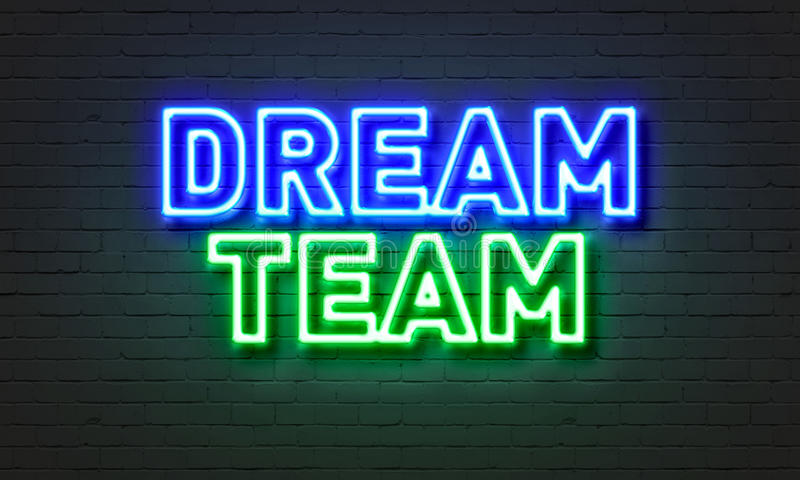 Traumteamleuchtreklame auf Backsteinmauerhintergrund lizenzfreies stockbild