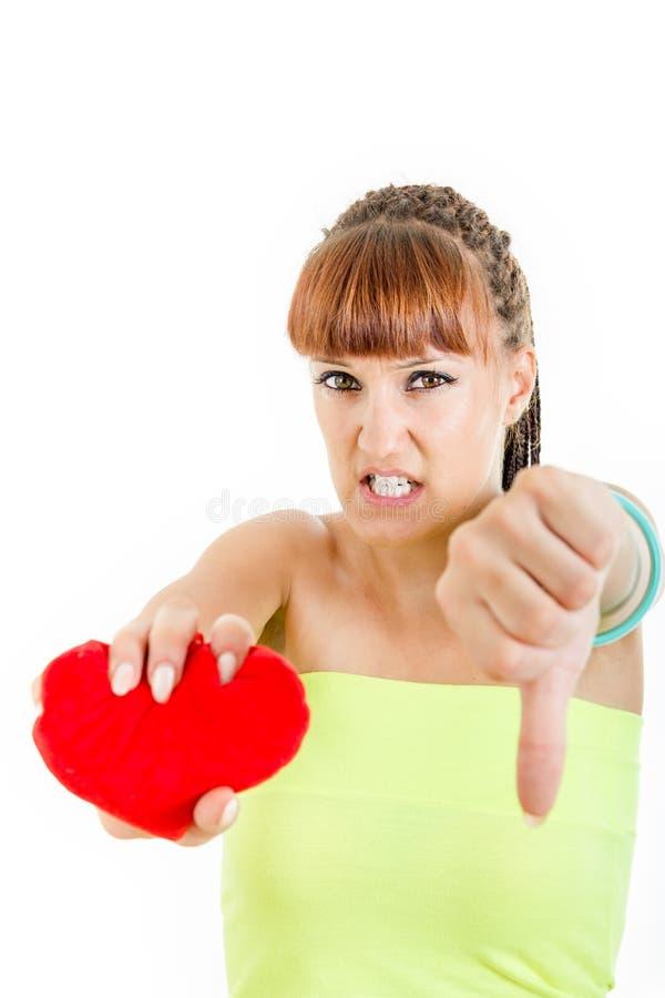 Traurige Frau mit dem defekten Herzen, das unter Liebe leidet stockfotos