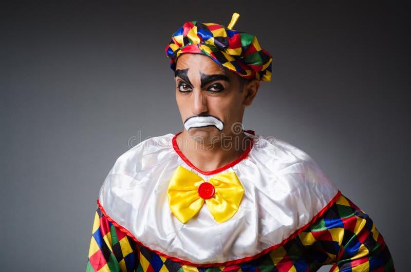 Trauriger Clown gegen lizenzfreies stockbild