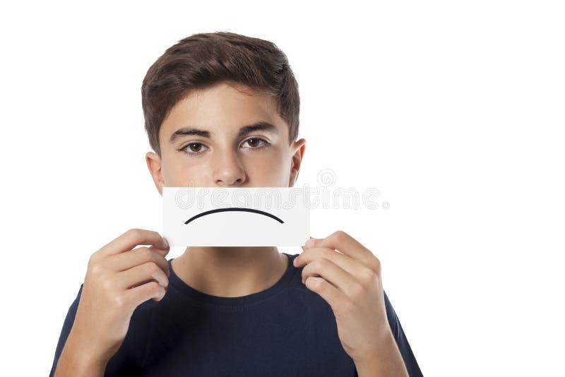 Trauriger Junge mit Emoticon lizenzfreies stockbild