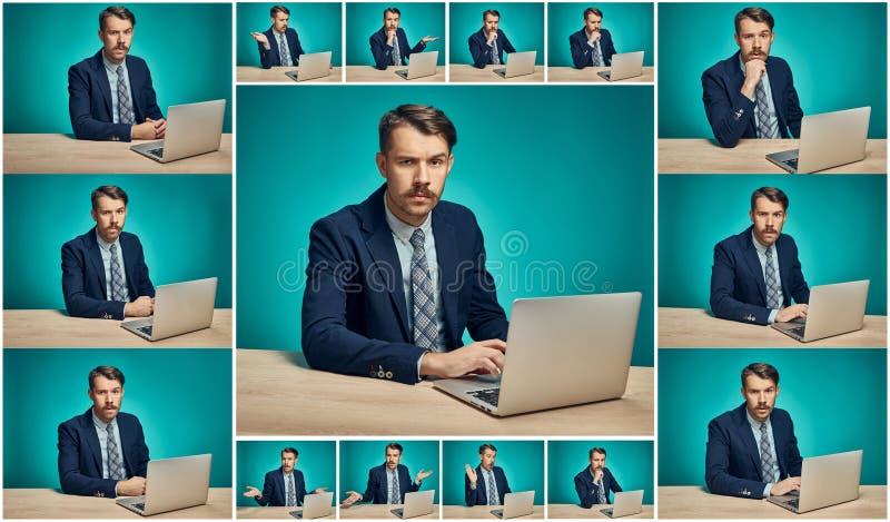 Trauriger junger Mann, der an Computer am Schreibtisch arbeitet stockfoto