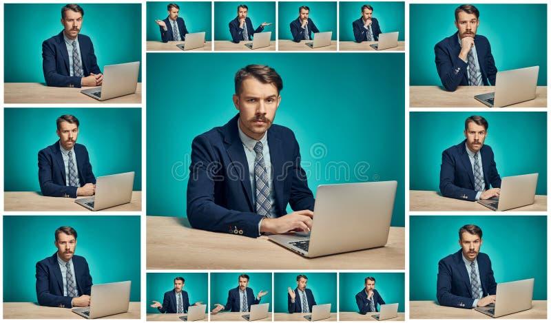 Trauriger junger Mann, der an Computer am Schreibtisch arbeitet lizenzfreie stockfotografie