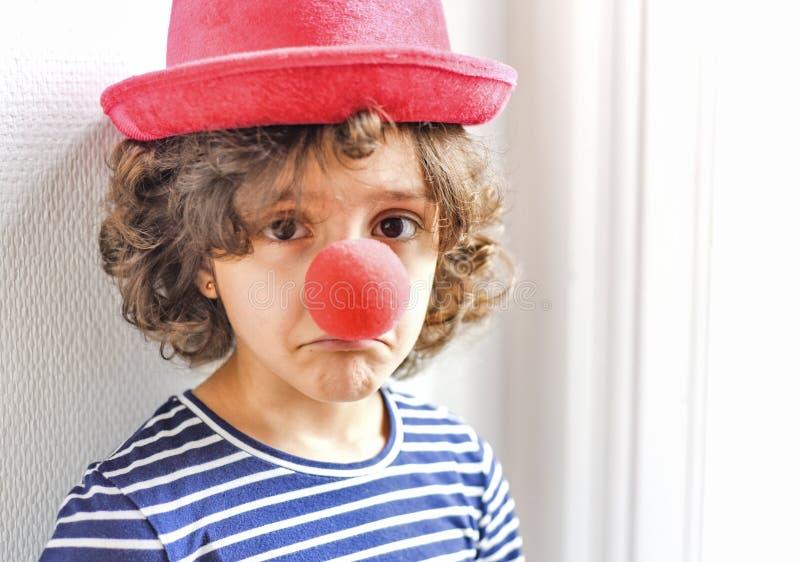 Trauriger kleiner Clown lizenzfreie stockbilder