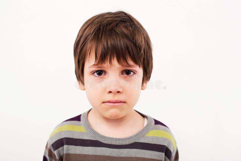 Trauriges Kindergesicht stockbild