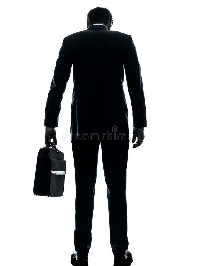 Trauriges stehendes Schattenbild der hinteren Ansicht des Geschäftsmannes lizenzfreie stockfotografie