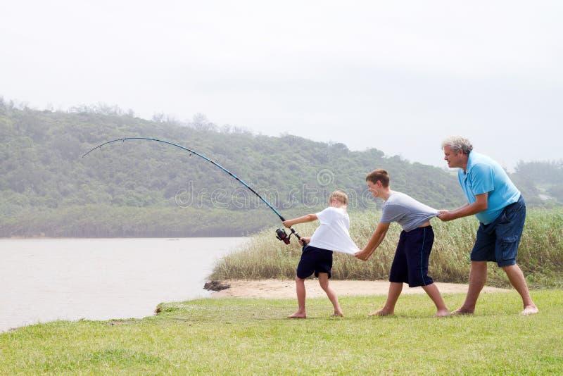Travail d'équipe de pêche photo stock