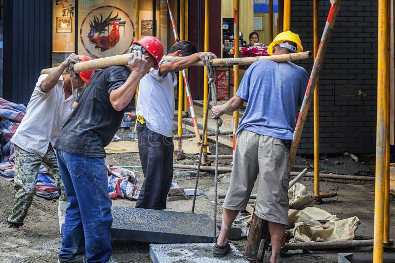 Travailler de travailleurs migrants photo libre de droits