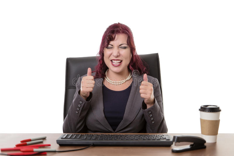 Travailler heureux dur dans le bureau photo stock