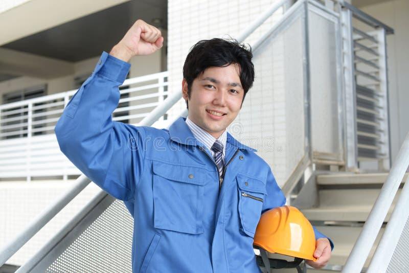Travailleur asiatique de sourire photos stock