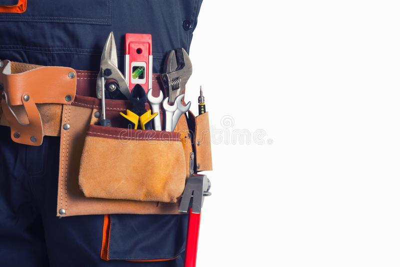 Travailleur avec la ceinture d'outil photo stock
