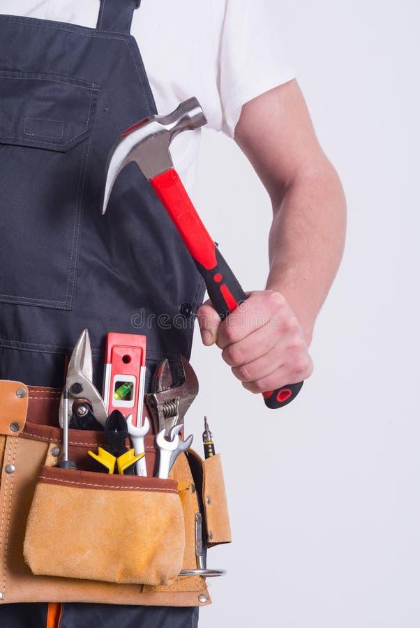 Travailleur avec la ceinture d'outil photo libre de droits