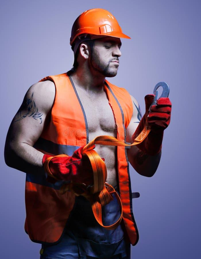 Travailleur d'hommes avec le casque orange images libres de droits