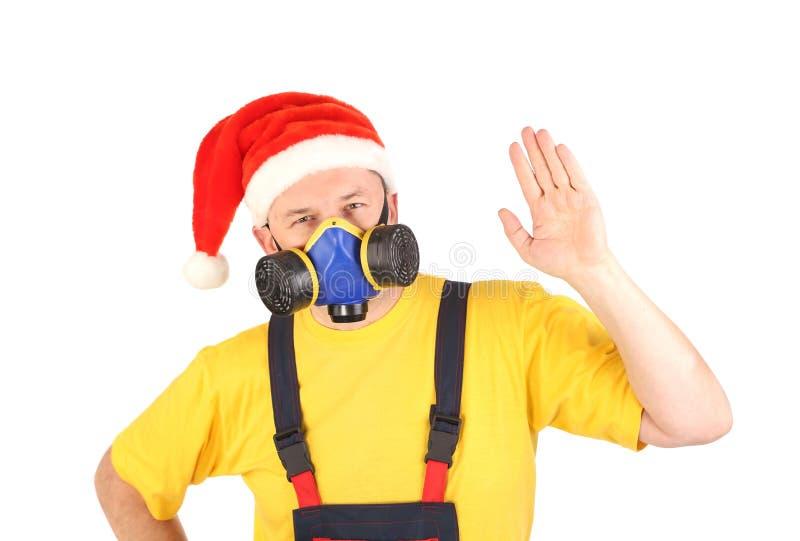Travailleur dans la main d'exposition de masque de gaz. photos stock