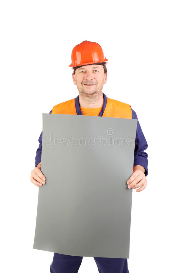 Travailleur dans le casque antichoc avec le papier photo libre de droits