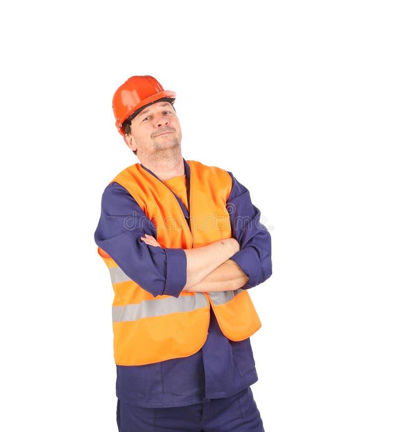 Travailleur dans le casque antichoc et le gilet image libre de droits