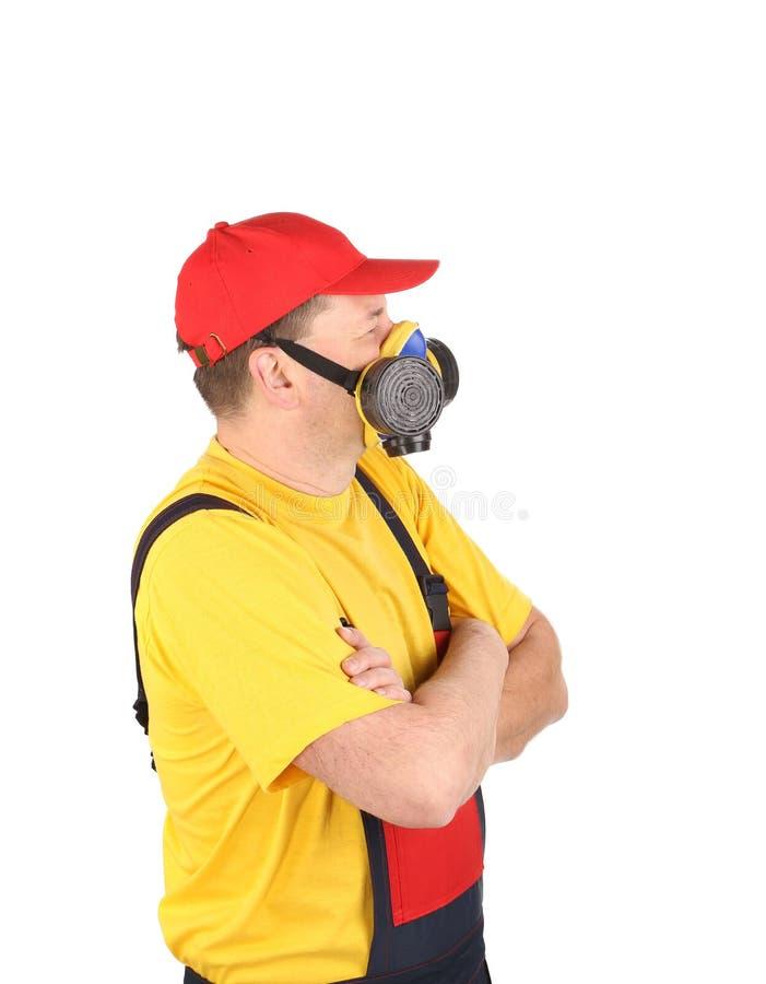 Travailleur dans le masque de gaz photos stock