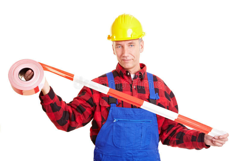 Travailleur de la construction avec la barrière photographie stock