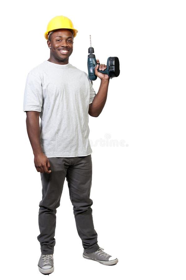 Travailleur de la construction avec le foret photo stock