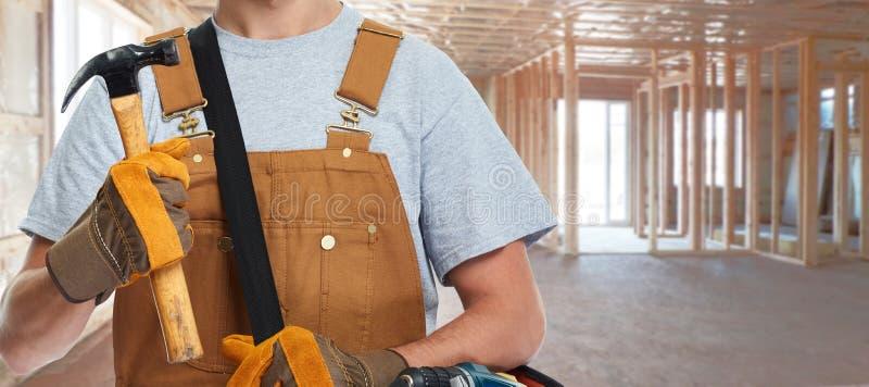 Travailleur de la construction avec le marteau photos libres de droits