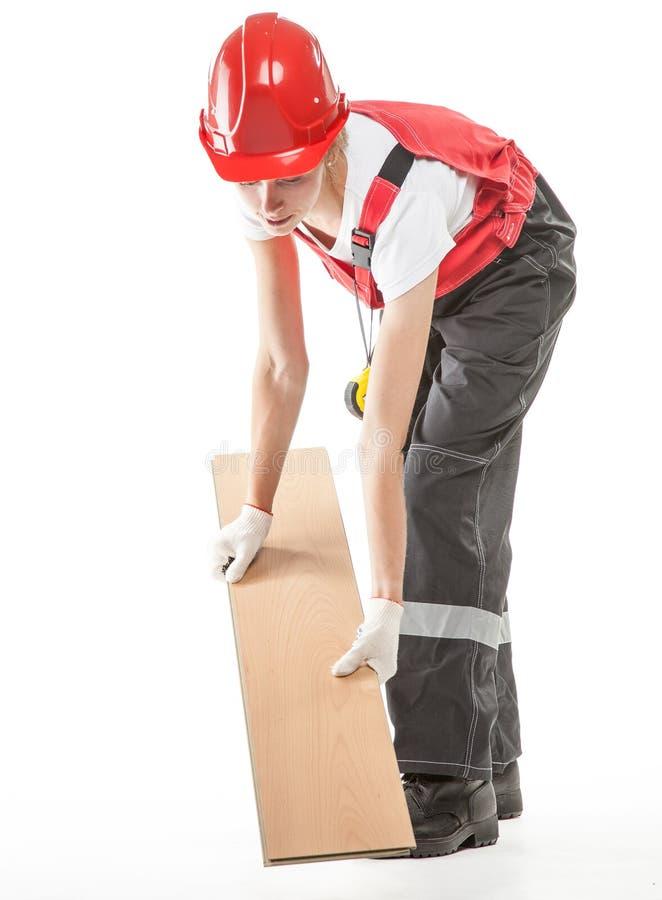 Travailleur de la construction avec le stratifié images stock
