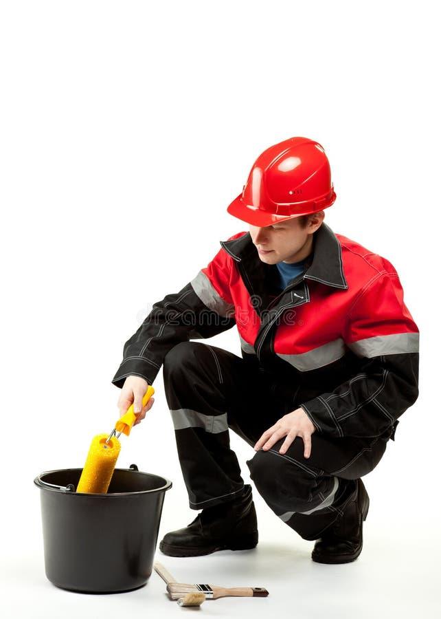 Travailleur de la construction dans l'uniforme photographie stock libre de droits