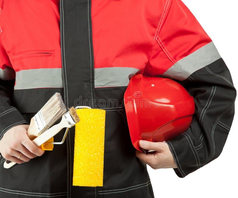 Travailleur de la construction dans l'uniforme avec des outils photographie stock