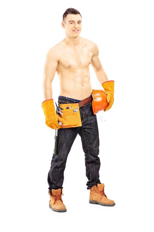 Travailleur de la construction de sexe masculin musculaire sans chemise image stock