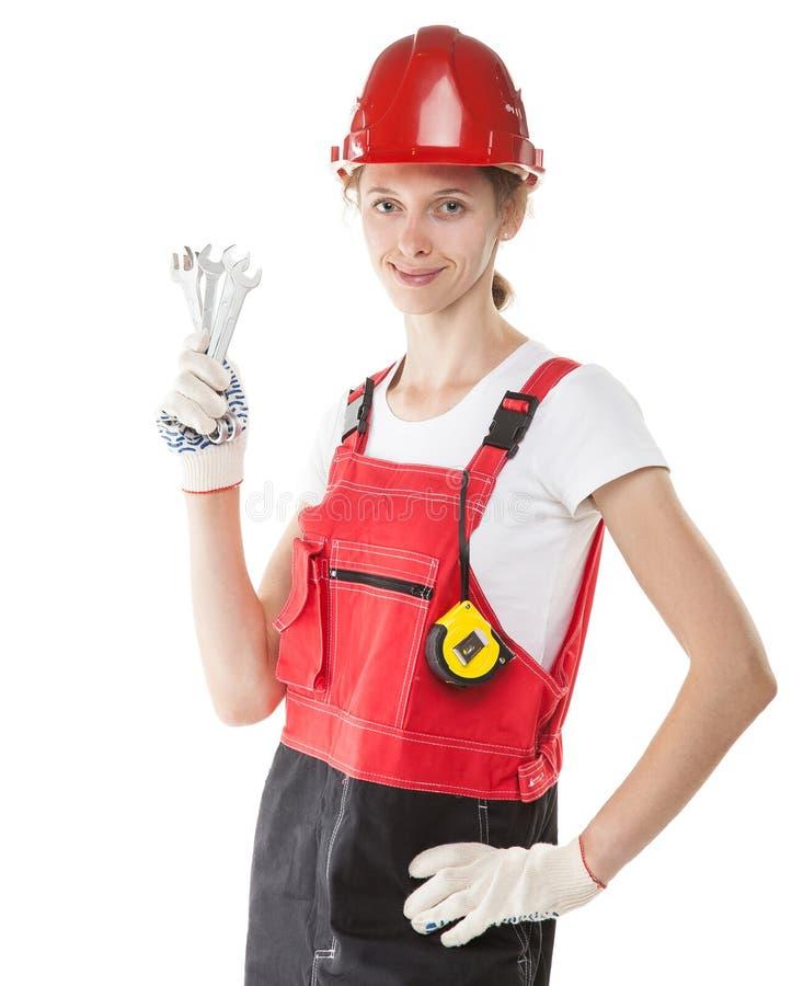 Travailleur de la construction de sourire dans l'uniforme avec des outils images stock