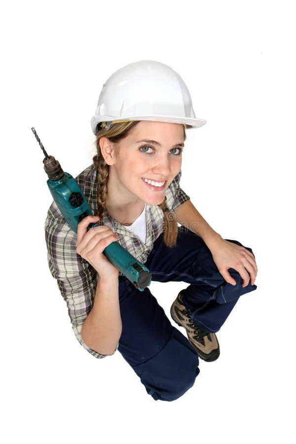 Travailleur de la construction féminin attirant images stock