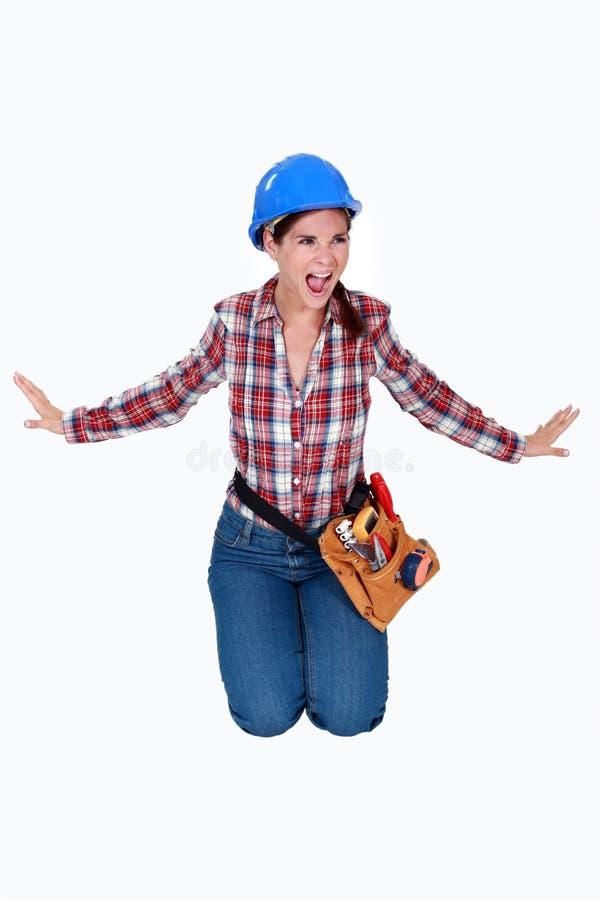 Travailleur de la construction féminin fâché. photographie stock libre de droits