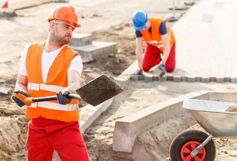 Travailleur de la construction fort image libre de droits