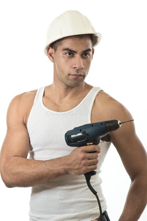 Homme avec un foret photographie stock libre de droits