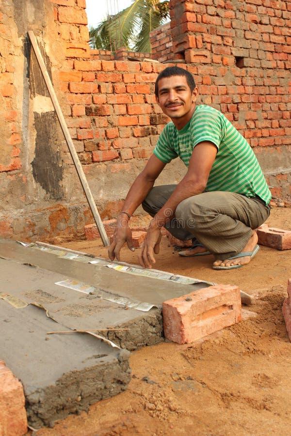 Travailleur de la construction indien images stock