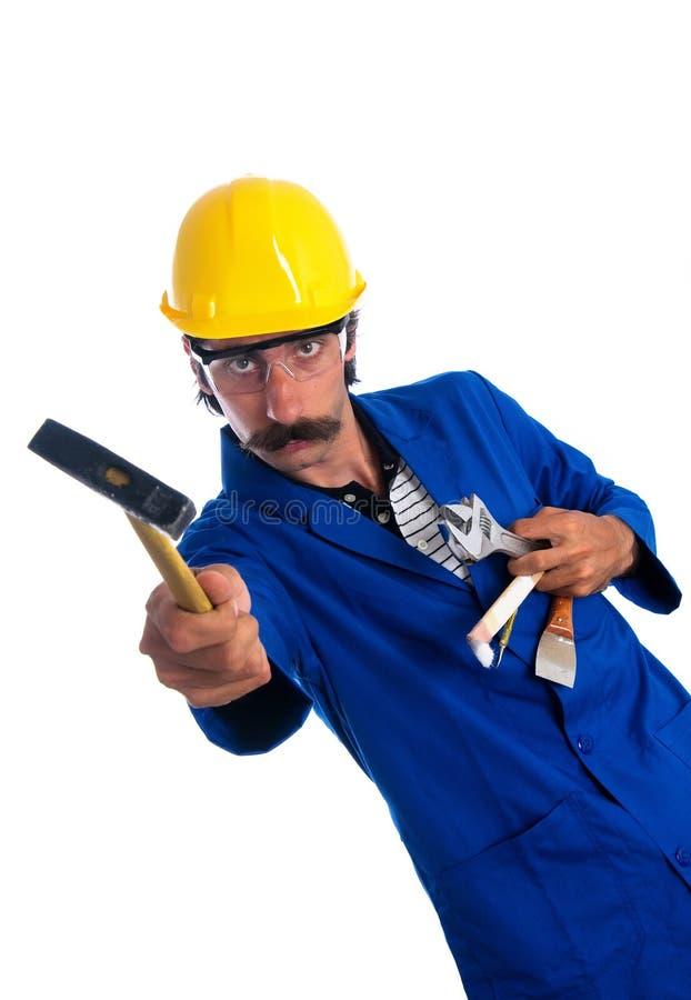 Travailleur de la construction maladroit affichant ses outils images stock