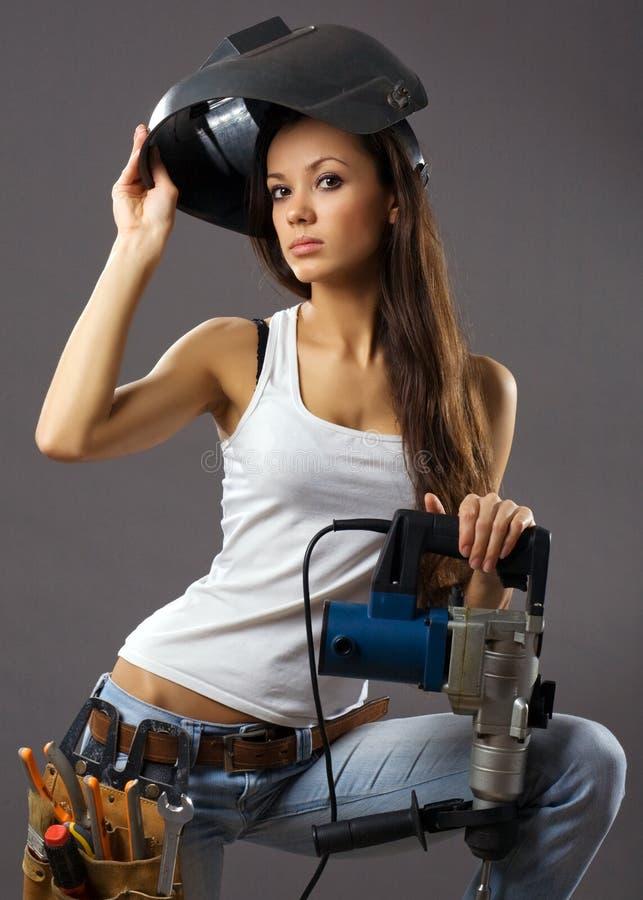 Travailleur de la construction sexy de jeune femme image libre de droits