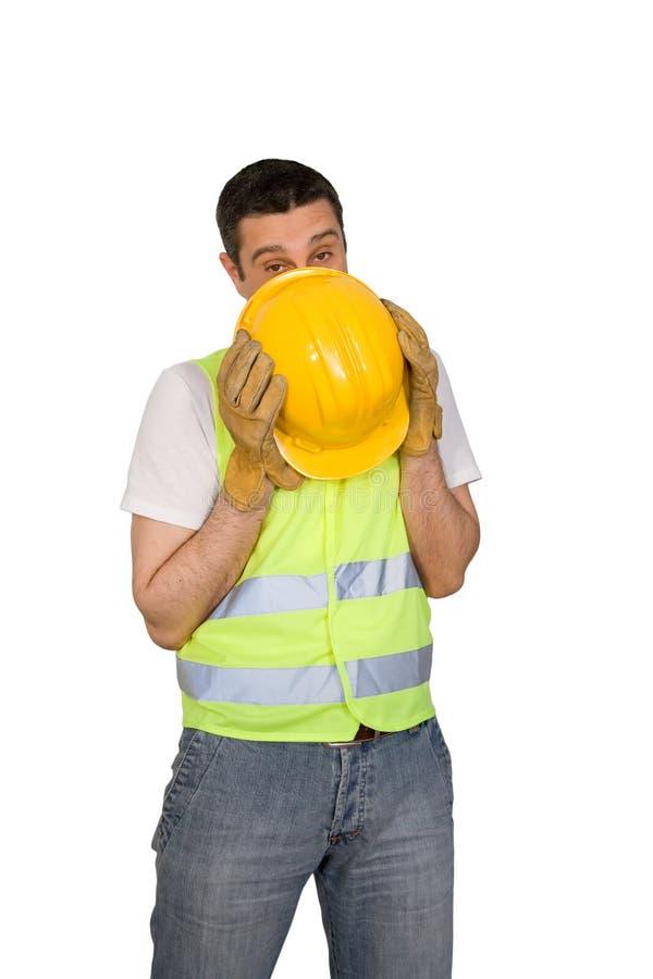 Travailleur de la construction timide images stock