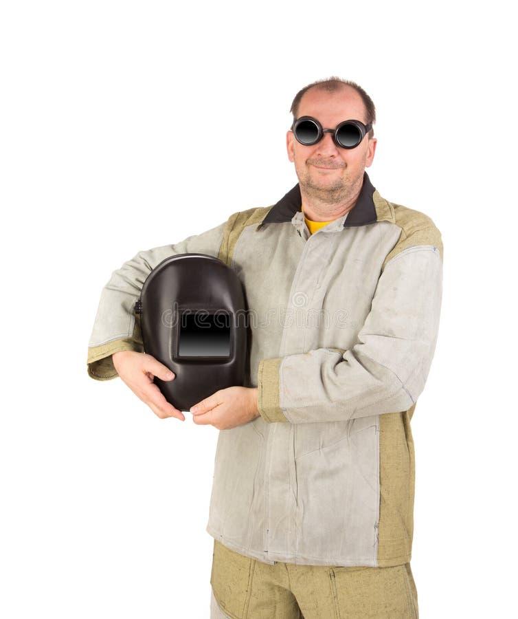 Travailleur tenant le masque de soudeuse photos libres de droits