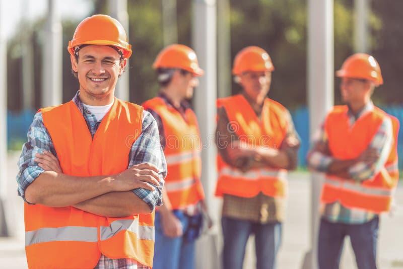 Travailleurs d'industrie du bâtiment photo libre de droits