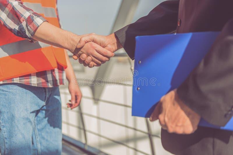Travailleurs d'industrie du bâtiment photos stock