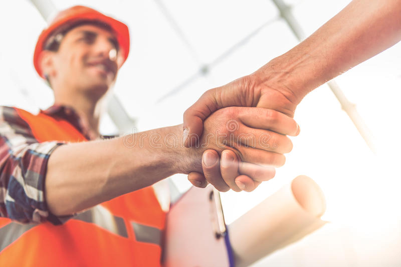 Travailleurs d'industrie du bâtiment images stock