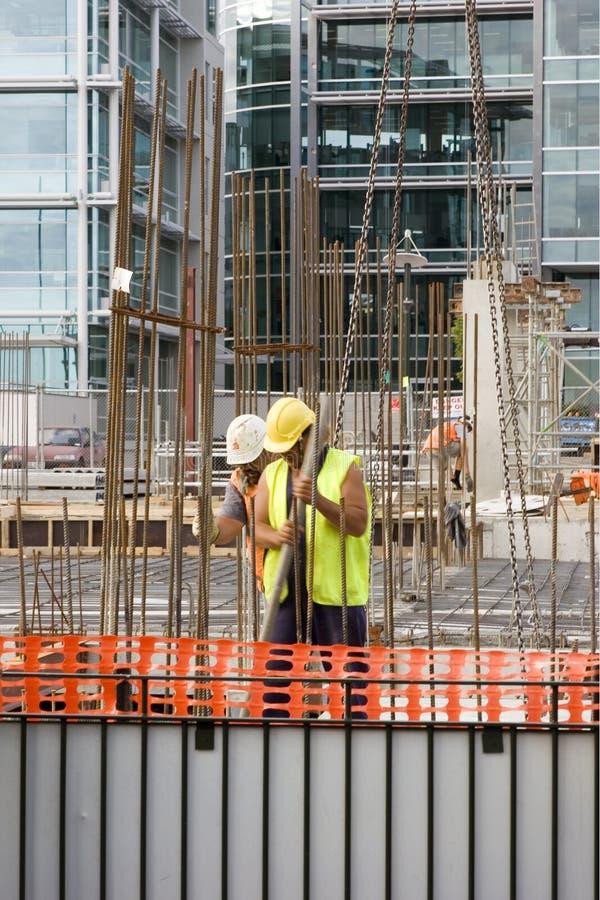 Travailleurs de la construction photo stock