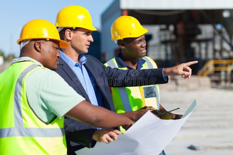 Travailleurs de la construction d'architecte photographie stock