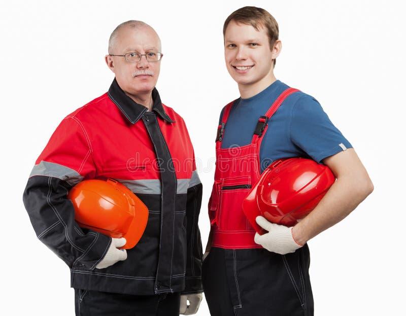 Travailleurs de la construction dans l'uniforme avec des masques photo libre de droits