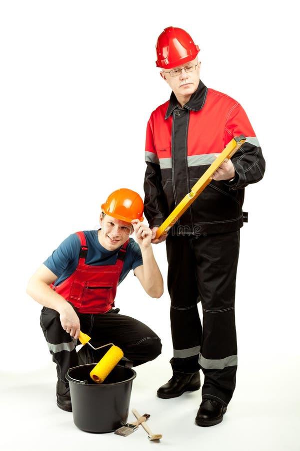 Travailleurs de la construction dans l'uniforme avec des outils photos libres de droits