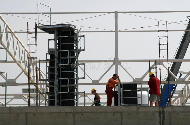 Travailleurs de la construction de corporation de construction photos libres de droits