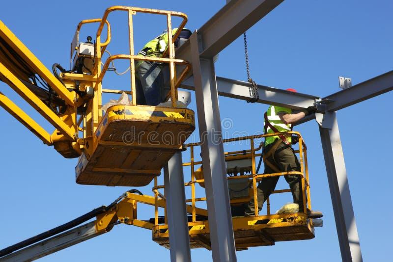 Travailleurs de la construction en acier photo stock