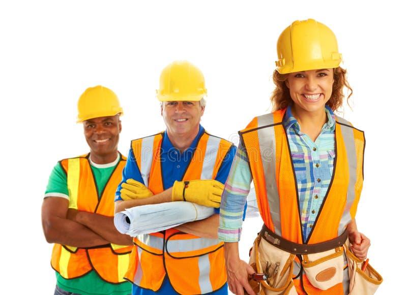 Travailleurs de la construction heureux photo stock