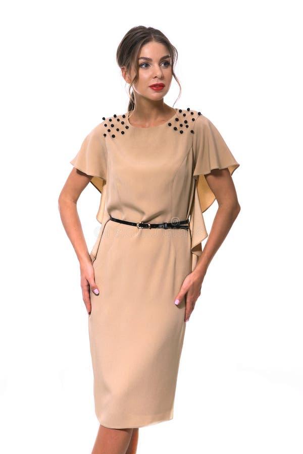 Travaillez comme employé la femme d'affaires de directeur dans la robe formelle beige photographie stock libre de droits