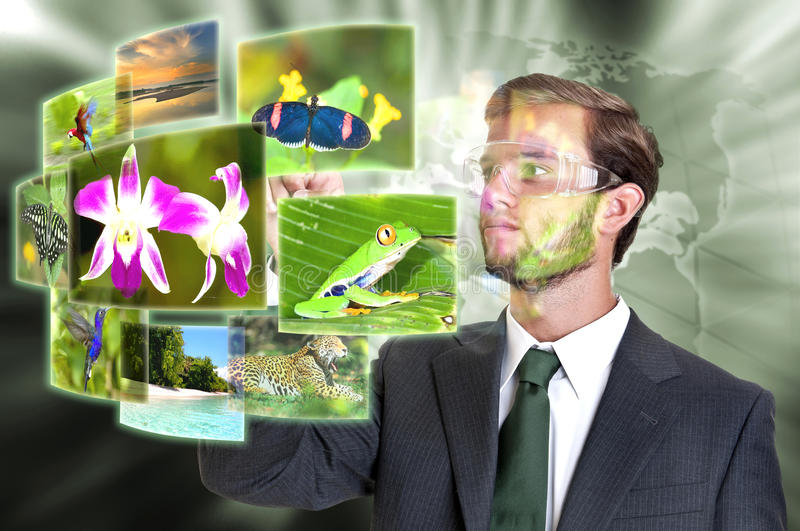 Travel. Young businessman with glasses looking at some nature and travel images royalty free stock images